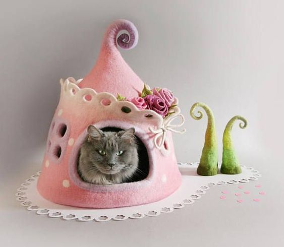 If you want own fairy tale in your house or pink heaven this house is for you  Made from yummy softest shade of pink wool looking like a marshmallow mixed with a cloud and decorated with different shades of pink roses and lacy roof ending this house will create a little prince or princess